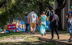 Voters approach a polling location in Austin, Texas, on October 13