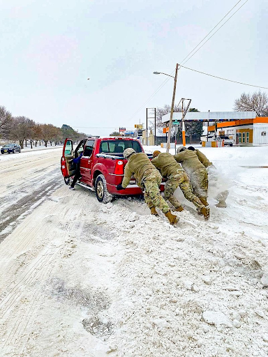 February 17, 2021. Texas Guardsmen assist a motorist stuck on snow and ice during extreme winter weather conditions in Abilene, Texas. Service members from the Texas Army, Air and State Guards worked in support of the Texas Department of Public Safety and Texas Division of Emergency Management transporting personal to safety, assisting stranded motorists, clearing roadways, manning warming centers, transporting critical infrastructure personnel to work, and delivering basic commodities like water, food, blankets and oxygen to Texans in need.
