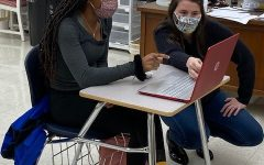 Mrs. White assisting a student in class.